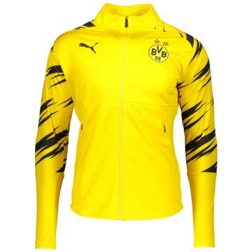 Puma Übergangsjacken gelb